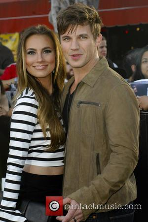 Matt Lanter and Angela Stacy - Film Premiere of Divergent - Los Angeles, California, United States - Wednesday 19th March...