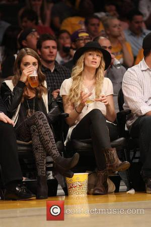 Beth Behrs - Wednesday March 19, 2014; Beth Behrs out at the Lakers game. The San Antonio Spurs defeated the...