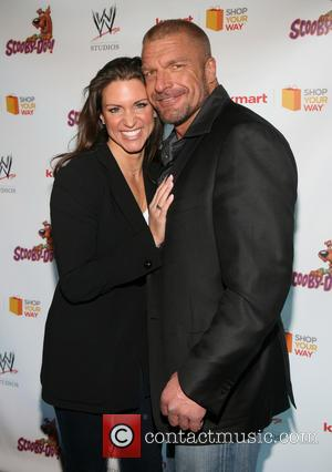 Stephanie McMahon, Triple H and Paul Michael Levesque - The world premiere of 'Scooby-Doo! WrestleMania Mystery' held at Tribeca Cinemas...