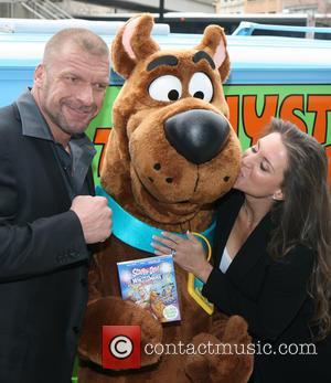 Triple H, Scooby Doo, Stephanie McMahon and Paul Michael Levesque - The world premiere of 'Scooby-Doo! WrestleMania Mystery' held at...