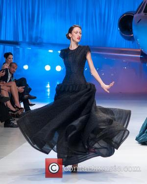 Model - The Fashion 2.0 Awards charity event featuring fashion designer Zac Posen Fall 2014 Collection at Signature Flight Support...