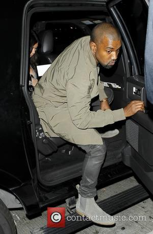 Kanye West - Kanye West and Kim Kardashian arrive at...