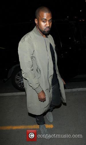kim kardashian - Kanye West and Kim Kardashian arrive at Los Angeles International (LAX) airport - Los Angeles, California, United...