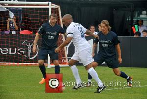 Quinton Fortune and Michel Salgado - Quinton Fortune of Team YR1M and Michel Salgado of Team Laureus in action during...