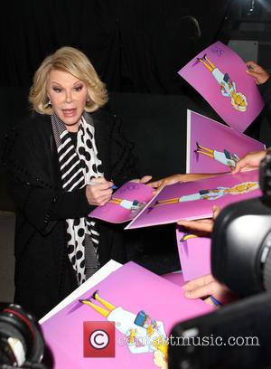 Joan Rivers - Joan Rivers appears to gesticulate at someone upon arriving at Los Angeles International Airport (LAX) - Los...