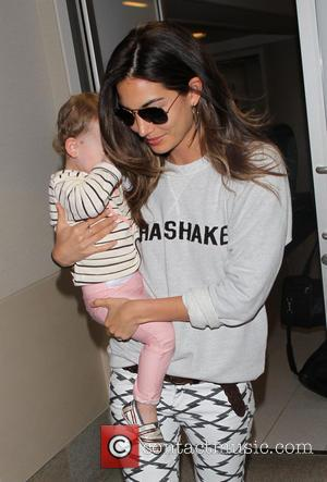 Lily Aldridge and Dixie Pearl Followill - Lily Aldridge arriving at Los Angeles International Airport (LAX) with her daughter, Dixie...