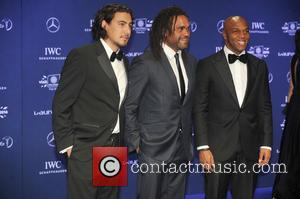 Christian Karembeu and Quinton Fortune - Laureus World Sports Awards at the Istana Budaya Theatre - Kuala Lumpur , Malaysia...