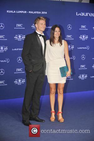Nico HUELKENBERG and girlfriend Laura - Laureus World Sports Awards at the Istana Budaya Theatre - Kuala Lumpur , Malaysia...