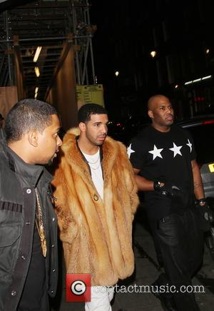 Drake - US recording artist Drake arrives at DSTRKT nightclub without Rihanna. The party ended early as fans stormed the...
