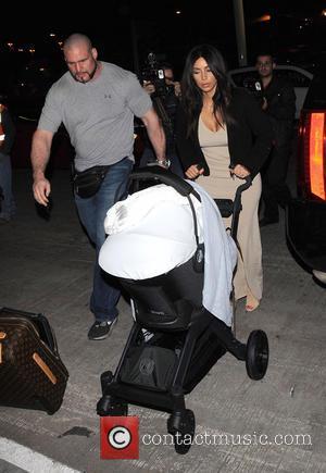 Kim Kardashian - Kim Kardashian with her daughter, North West at Los Angeles International Airport (LAX) - Los Angeles, California,...