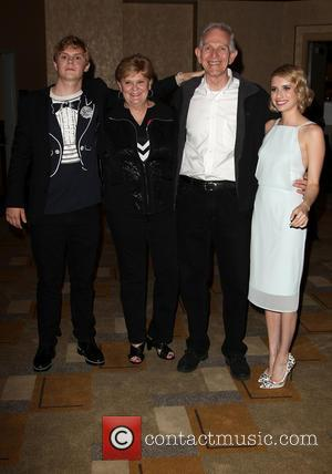 Evan Peters, Phil Peters, Julie Peters and Emma Roberts