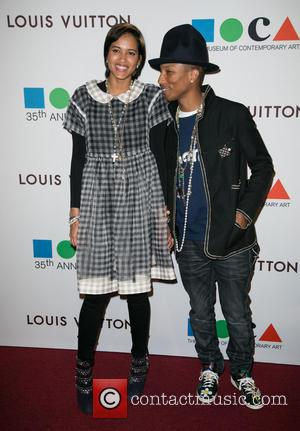 Helen Lasichanh and Pharrell Williams