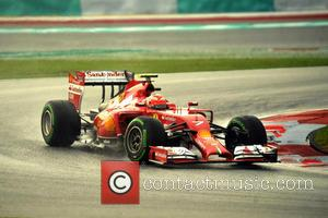 Kimi Räikkönen and (RAIKKONEN) - 2014 Formula 1 Malaysian Grand Prix - Sepang International Circuit - Qualifying - Sepang, Malaysia...