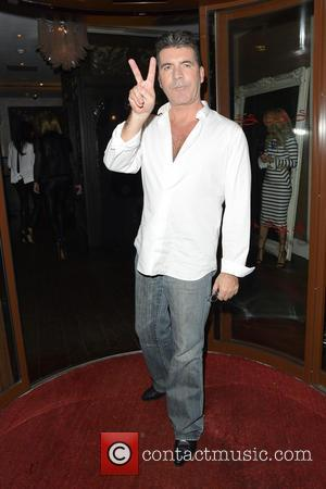 Simon Cowell - Simon Cowell and Lauren Silverman at Sanctum Soho - London, United Kingdom - Saturday 29th March 2014