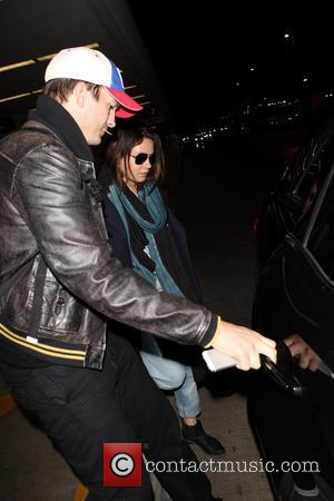 Ashton Kutcher and Mila Kunis - Ashton Kutcher and pregnant fiancee Mila Kunis get into a waiting car at Los...