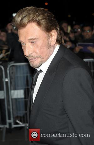 Johnny Hallyday - Johnny and Laticia Hallyday at the Salaud on T'aime Film Premiere - Paris, France - Monday 31st...