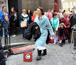 Saoirse Ronan - Actress Saoirse Ronan returning back onset wearing a dressing gown with a nightdress underneath, on the first...