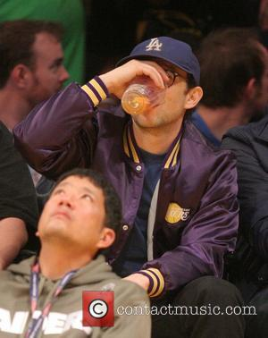 Joseph Gordon-Levitt - Sunday March 30, 2014; Celebs out at the Lakers game. The Los Angeles Lakers defeated the Phoenix...