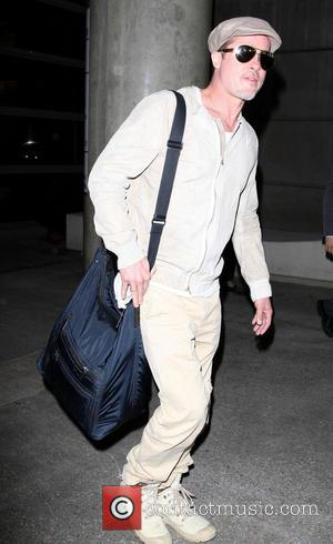 Brad Pitt - Brad Pitt arrives at LAX