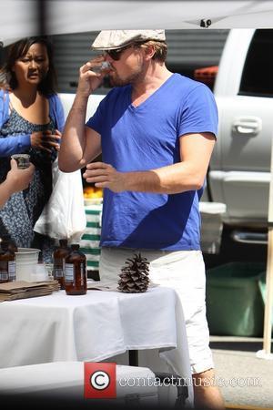 Leonardo DiCaprio - Leonardo DiCaprio and Toni Garrn shopping at the Beverly Hills Farmers Market. Leonardo DiCaprio took particular interest...