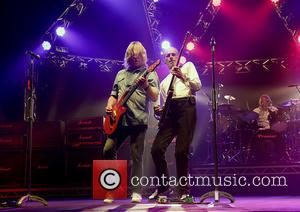 Francis Rossi and Rick Parfitt - Status Quo performing live on stage on their 'Frantic Four' tour at Manchester O2...