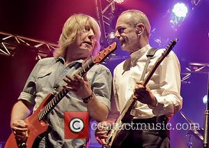 Rick Parfitt and Francis Rossi - Status Quo performing live on stage on their 'Frantic Four' tour at Manchester O2...