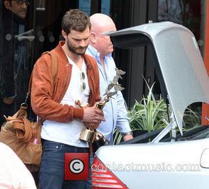 Jamie Dornan - Fifty Shades of Grey actor Jamie Dornan seen leaving The Doubletree Hilton Hotel Dublin carrying his IFTA...