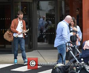 Jamie Dornan, Amelia Warner and daughter - The day after The IFTA awards, actors are seen coming and going from...