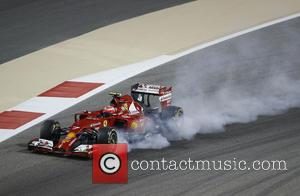 Kimi Räikkönen and (RAIKKONEN) - 2014 Formula 1 Gulf Air Bahrain Grand Prix - Bahrain International Circuit - Manama, Bahrain...