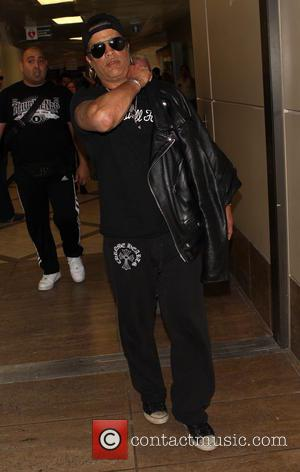Slash - Slash arrives at Los Angeles International (LAX) airport - Los Angeles, California, United States - Monday 7th April...