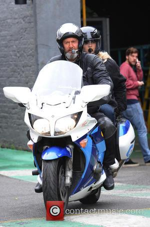 Holly Willoughby - Holly Willoughby seen leaving itv studios on the bike of a motor bike after presenting this morning....