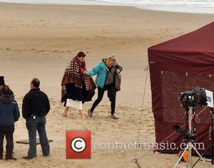Domhnall Gleeson - Actress Saoirse Ronan filming scenes for movie 'Brooklyn' with actor Domhnall Gleeson on Curracloe Beach this afternoon....
