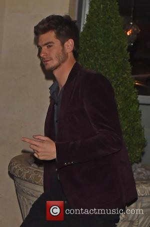 Andrew Garfield - Spider-Man 2 cast members Emma Stone and Andrew Garfield arrive back at their hotel together after recording...