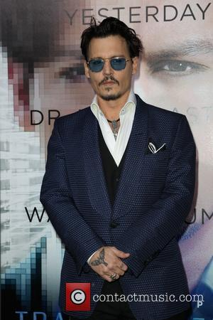 Johnny Depp - Los Angeles premiere of Warner Bros. Pictures and Alcon Entertainment's 'Transcendence' at Regency Village Theatre - Los...