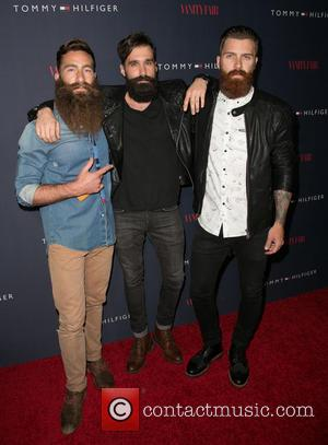 Jimmy Niggles, Levi Stocke and Guest - Celebrities attend the Zooey Deschanel for Tommy Hilfiger Collection launch event at The...
