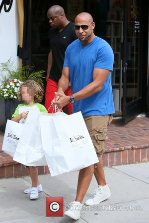 Hank Baskett and Hank Baskett IV - Hank Baskett and son Hank Baskett IV seen leaving Bel Bambini children's store,...