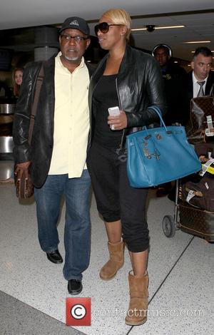NeNe Leakes and Gregg Leakes - NeNe Leakes arrives at Los Angeles International Airport (LAX) carrying her blue Hermes Birkin...