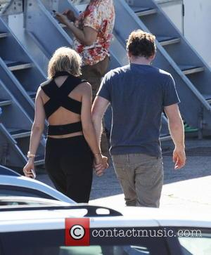 Sam Worthington and Lara Bingle - Sam Worthington gets a visit from girlfriend Lara Bingle on the set of