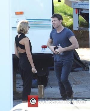 Sam Worthington and Lara Bingle - Sam Worthington gets a visit from girlfriend Lara Bingle on the set of