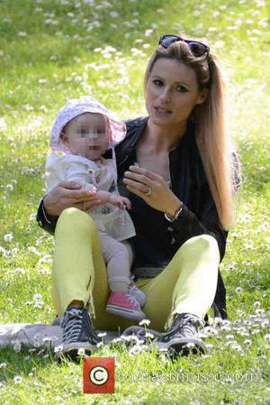 Michelle Hunziker and Sole Trussardi - Michelle Hunziker spends the day at a park with her daughter Sole and dog...