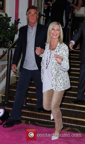 Olivia Newton John and John Easterling -