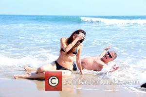 Blanca Blanco and John Savage - John Savage and his young actress girlfriend Blanca Blanco frolicking in the surf on...