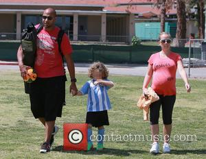 Hank Baskett, Hank Basket IV and Kendra Wilkinson - A heavily pregnant Kendra Wilkinson and husband Hank Baskett taking their...