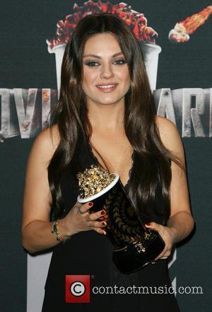 Mila Kunis - MTV Movie Awards 2014 Press Room