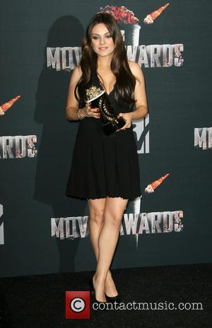 Mila Kunis Drops Pregnancy Hint At Mtv Movie Awards