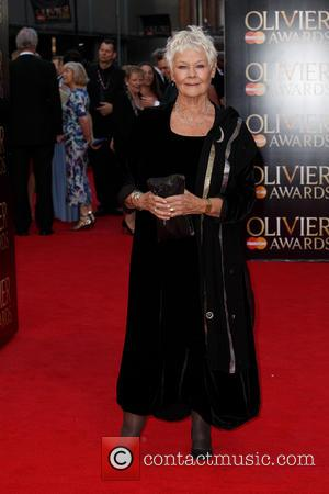 Dame Judi Dench - The Olivier Awards 2014 with MasterCard held at the Royal Opera House - Arrivals - London,...