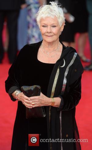Judi Dench - Olivier Awards 2014 held at the Royal Opera House - Arrivals - London, United Kingdom - Sunday...