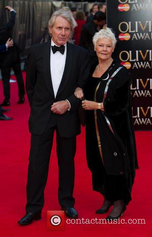 Dame Judi Dench - The Laurence Olivier Awards 2014 held at the Royal Opera House - Arrivals - London, United...