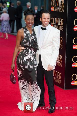 Beverley Knight and Guest - Olivier Awards 2014 held at the Royal Opera House - Arrivals - London, United Kingdom...