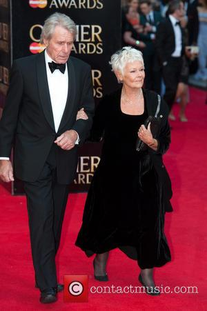Dame Judi Dench and David Mills - Olivier Awards 2014 held at the Royal Opera House - Arrivals - London,...